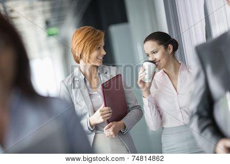 Businesswomen walking in office corridor