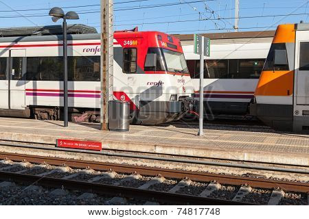 Modern Passenger Electric Trains Stand On Railway Station