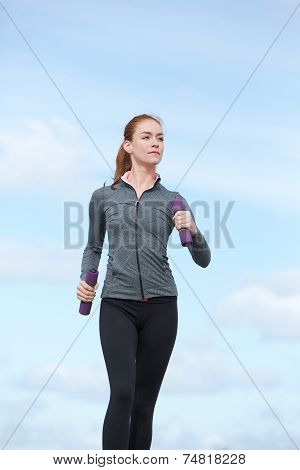 Young Woman Keeping Fit By Power Walking