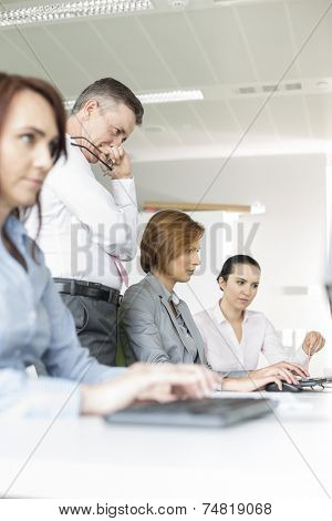 Business people working in office