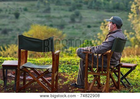 Man enjoying evening on safari trip in Africa