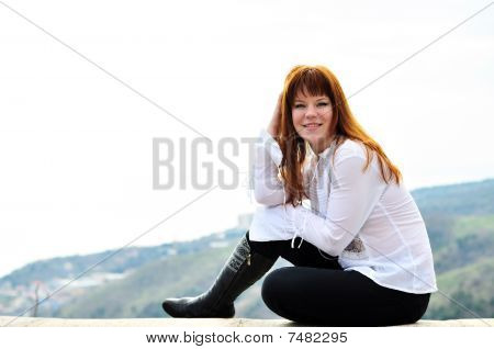 Sitting Redheaded Girl