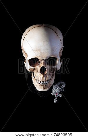 Human skull with silver cross