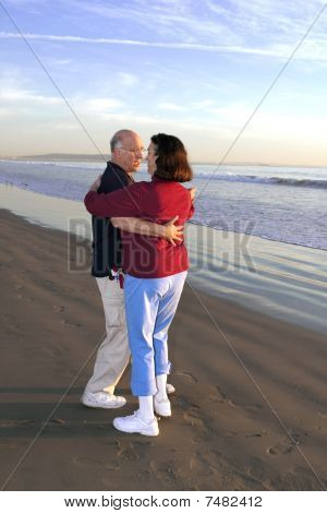 Older Couple Dancing On Beach