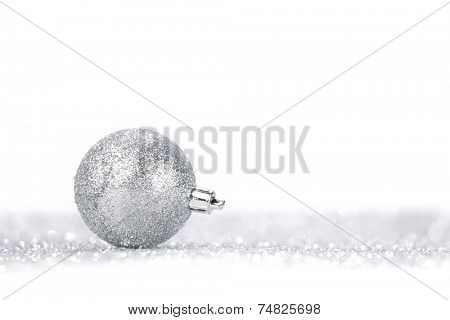 Beautiful Glitter christmas ball close-up on shining background