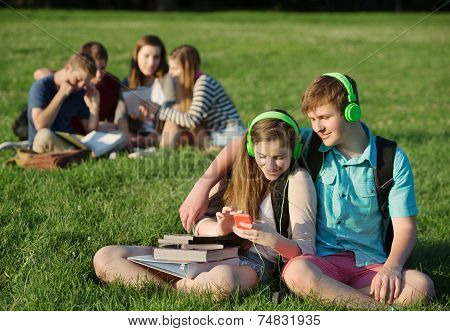 Friends Listening To Mp3 Player