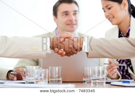 Close-up Of Two Business People Greeting Each Other