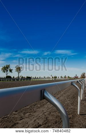 Railing Along a Horse Race Track