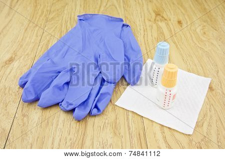 Eye Drops Put On Tissue Paper And Latex Glove