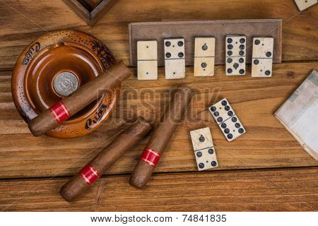 Pure Cigars And Domino Board On Table