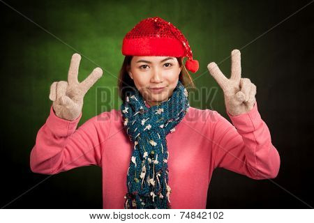 Asian Girl With Red Christmas Hat Show V Sign