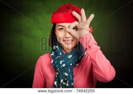 Asian Girl With Red Christmas Hat With Ok Hand Over Eye