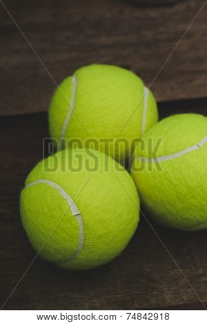 Few tennis balls on the table