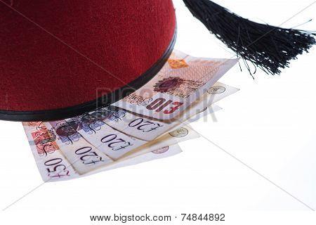 Hotel Boy Hat And British Money Isolated