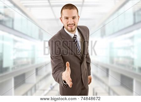 businessman offering to shake the hand, at the office