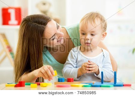 little boy and mother with building blocks