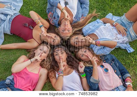 group of teens saying silence