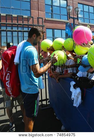 Professional tennis player Marin Cilic signing autographs after practice for US Open 2014