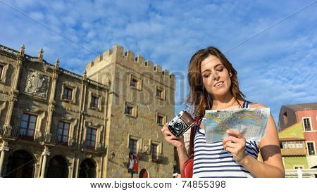 Tourist With Guide Map And Camera