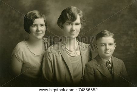 CANADA - CIRCA 1940s: Vintage photo shows Family portrait of a mother, her son and daughter
