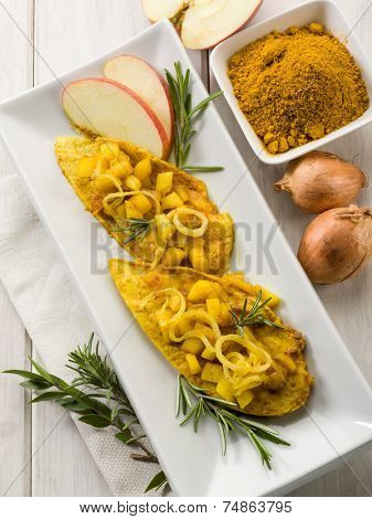 escalope with apple onions and curry
