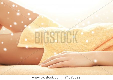 people, beauty, health and leisure concept - close up of beautiful young woman in towel indoors