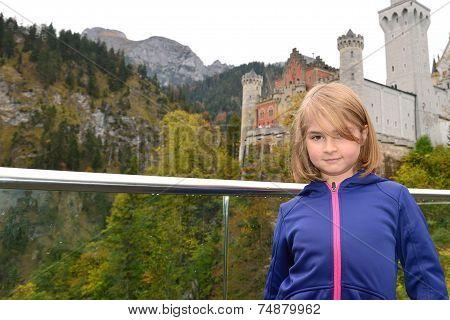 Little girl visiting a castle