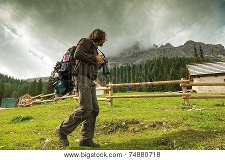 Landscape Italy Dolomites - Men photographer hiking at the shelter house