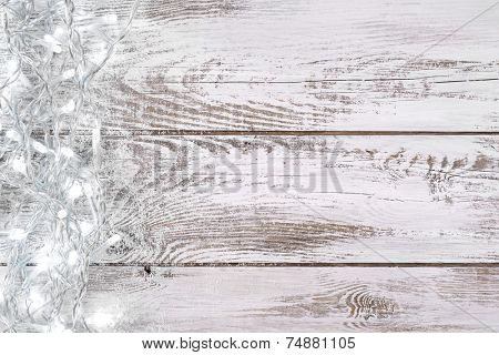 Christmas decoration with lights and white, wooden background