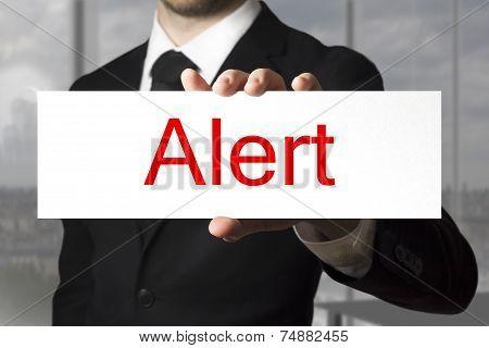 Businessman Holding Sign Alert