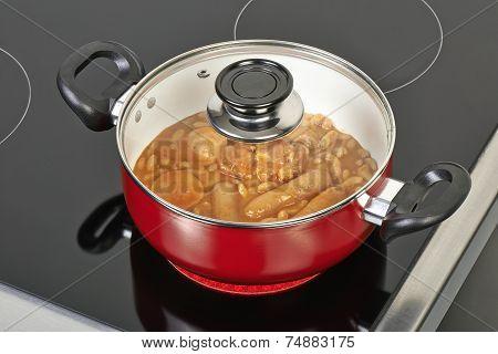 Preparing Cassoulet In Red Ceramic Pan