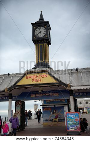 BRIGHTON - APRIL 06 - Brighton Pier Clock Tower Under Cloudy Skies in Brighton, England on April 06, 2014