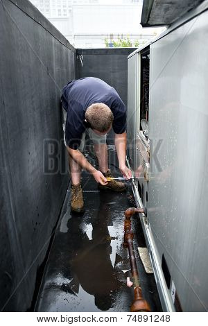 HVAC Technician Working