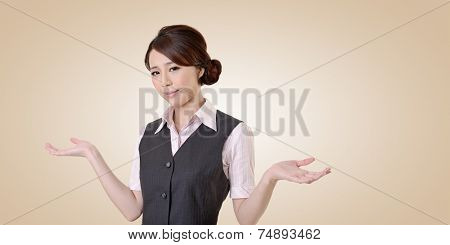 Helpless young business woman shrugs her shoulders. closeup portrait with clipping path.