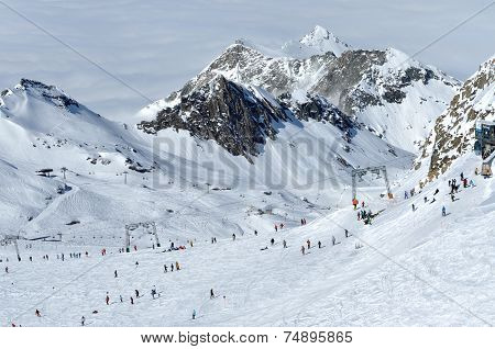Skiers skiing on the piste