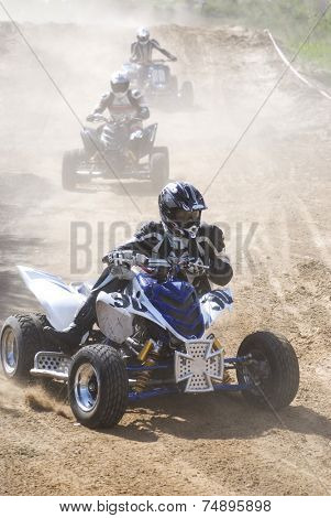 Quad motorcycles racing in the road-metal