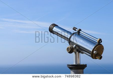 Touristic Metal Spyglass On The Sky Background