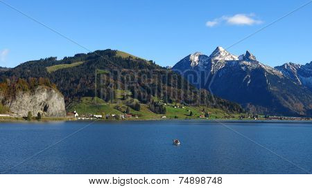 Lake Sihlsee And Snow Capped Mountains