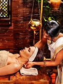 foto of ayurveda  - Young woman having oil Ayurveda spa treatment - JPG