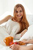 image of bed breakfast  - Women gets breakfast in bed for her boyfriend - JPG