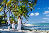 picture of deserted island  - Beautiful family of mother and two kids on a deserted island - JPG