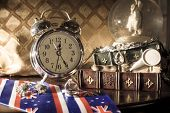 stock photo of pass-time  - Vintage clocks background. Pass of time concept [[** Note: Shallow depth of field ** Note: Visible grain at 100%, best at smaller sizes - JPG