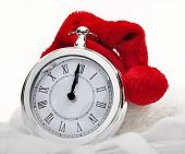 foto of pendulum clock  - Santa claus hat on a clock striking midnight - JPG