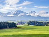 stock photo of bavaria  - Landscape in Allgau Bavaria with mountains and meadows - JPG