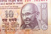 stock photo of indian currency  - Closeup macro view of Mahatma Gandhi on an Indian currency note - JPG