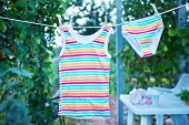 picture of clotheslines  - washed baby clothes dried on the clothesline outdoors