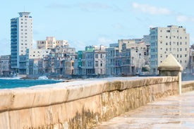 image of malecon  - The famous malecon seawall in Havana vith a view of the city skyline - JPG