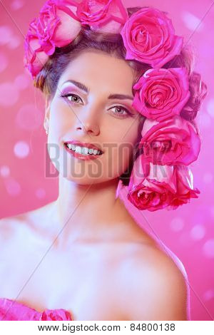 Beautiful tender girl with floral hairstyle. Roses. Cosmetics. Beauty, fashion. Spring and summer.