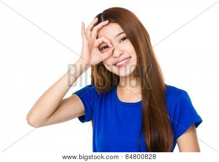Woman with ok gesture on eye