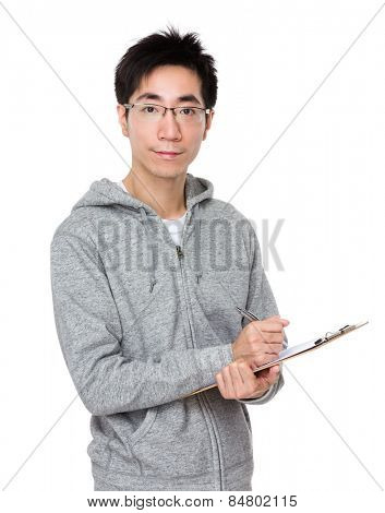 Man write on clipboard